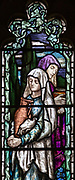Detail of stained glass window of Mary Magdalene, Great Cheverell church, by Mary Lowndes 1909