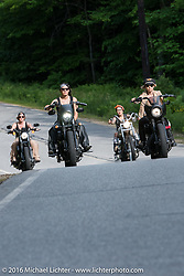 Iron Lilies Lilly James (L), Leticia Cline (R), Dana Cooley (back left) and Kissa Von Addams (back rt) out riding during Laconia Motorcycle Week 2016. NH, USA. Sunday, June 19, 2016.  Photography ©2016 Michael Lichter.