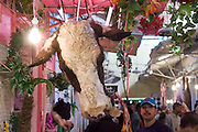 A decapitated cow head hangs at a butcher stall at a market in Meknes, Morocco on November 1, 2007.