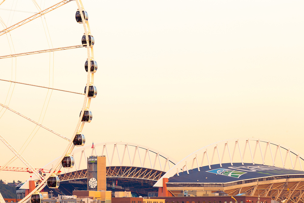 Seattle, Washington State, United States - Centurylink Field sports stadium at Pioneer Square district and Seattle Great Wheel.