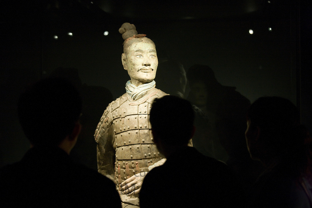 Tourists view three coloured Terracotta warrior, on display in the Shaanxi History Museum, Xian, China