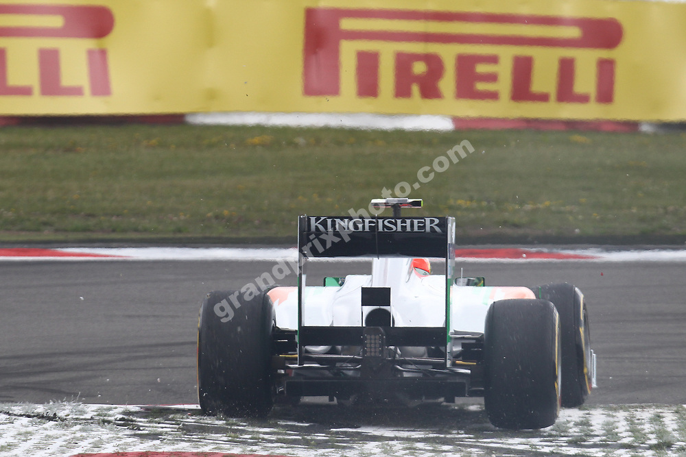 Paul di Resta (Force India-Mercedes) goes off the circuit during practice for the 2011 German Grand Prix at the Nurburgring. Photo: Grand Prix Photo