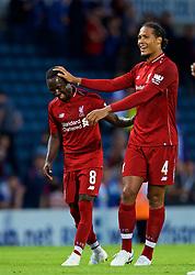 BLACKBURN, ENGLAND - Thursday, July 19, 2018: Liverpool's Naby Keita and Virgil van Dijk share a joke after a preseason friendly match between Blackburn Rovers FC and Liverpool FC at Ewood Park. Liverpool won 2-0. (Pic by David Rawcliffe/Propaganda)