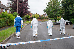 © Licensed to London News Pictures. 21/06/2021. Burnham, UK. Members of a Thames Valley Police search team at the scene following the death of a man in Wyndham Crescent in Burnham on Monday 20/06/2021. Emergency services were called at approximately 13:10BST to the Buckinghamshire street following reports of an altercation involving a group of men. Shortly after this a 35-year-old man collapsed. Thames Valley Police officers and paramedics attended the scene and performed CPR on the man but he was later pronounced dead. Photo credit: Peter Manning/LNP