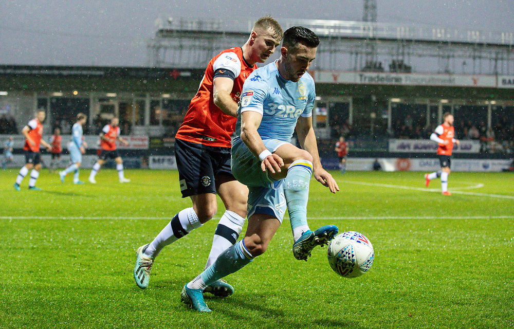 Leeds United's Jack Harrison shields the ball from Luton Town's James Bree<br /> <br /> Photographer Alex Dodd/CameraSport<br /> <br /> The EFL Sky Bet Championship - 191123 Luton Town v Leeds United - Saturday 23rd November 2019 - Kenilworth Road - Luton<br /> <br /> World Copyright © 2019 CameraSport. All rights reserved. 43 Linden Ave. Countesthorpe. Leicester. England. LE8 5PG - Tel: +44 (0) 116 277 4147 - admin@camerasport.com - www.camerasport.com
