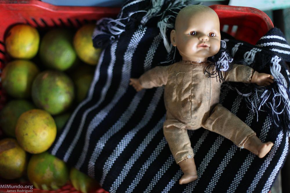 Doll on top of an orange crate. Punta Gorda, Toledo, Belize. January 28, 2013.