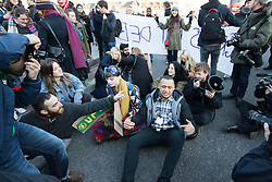 "Westminster, London, January 19th 2016. Students hold an ""emergency protest"" in Parliament Square and later blocking Westminster Bridge, against the cutting of maintenance grants. ""It took just 18 MPs 90 minutes to scrap maintenance grants for the million poorest students, without a debate in Parliament in a backroom committee"" PICTURED: Protesters stage a sit-in on Westminster Bridge. ///FOR LICENCING CONTACT: paul@pauldaveycreative.co.uk TEL:+44 (0) 7966 016 296 or +44 (0) 20 8969 6875. ©2015 Paul R Davey. All rights reserved."