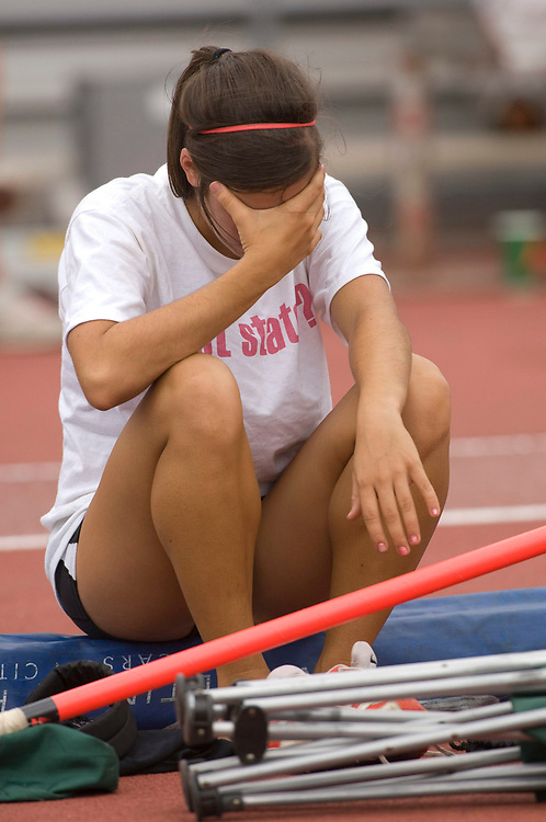 Austin, TX May 10, 2008:  Anglo girl cries in disappointment after failing to win a medal in the pole vauil at the Texas state UIL High School Track meet at the University of Texas at Austin.      ©Bob Daemmrich