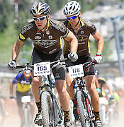 SHOT 6/4/11 11:52:13 AM - Courtney Gregory (#165) of Gypsum, Co. and Sylvan Ellefson (#178) of Vail, Co. race up a hillside during the Single Speed Men's race at the 10th Annual Teva Mountain Games in Vail, Co. Ellefson finished second while Gregory finished fourth in the event. Professional and amateur outdoor adventure athletes from the Vail Valley and around the world will converge upon the mountains and rivers of Vail to compete in eight sports and 23 disciplines including: x-country, freeride, slopestyle and road cycling, freestyle, 8-Ball, sprint and extreme kayaking, raft cross, World Cup Bouldering, stand up paddle sprint and surf cross, as well as trail, mud and road running, dog comps and the GNC Ultimate Mountain Challenge.. (Photo by Marc Piscotty / © 2010)