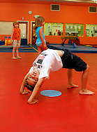 Gymnastics and dance classes are offered at The Little Gym in Brentwood on Saturday, May 19, 2012.  (Photo by Kevin Bartram)