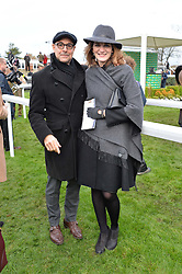 STANLEY TUCCI and FELICITY BLUNT at the 2015 Hennessy Gold Cup held at Newbury Racecourse, Berkshire on 28th November 2015.