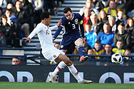 Scotland defender Andrew Robertson (3) (Liverpool) and Portugal forward Helder Costa (10) (Wolverhampton Wanderers)  during the Friendly international match between Scotland and Portugal at Hampden Park, Glasgow, United Kingdom on 14 October 2018.