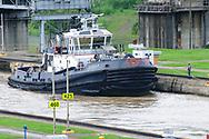 Tugboat crossing the Miraflores Locks at the Panama Canal.