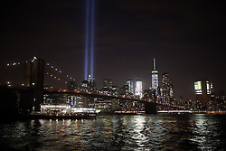 "NEW YORK, UNITED STATES - SEPTEMBER 10: 9/11 Memorial ""Tribute in Light"" is seen in Manhattan skyline from Brooklyn Bridge Park in Brooklyn, New York, USA on September 10, 2016 on a day before the 15th anniversary of the 9/11 attacks. Mohammed Elshamy / Anadolu Agency  