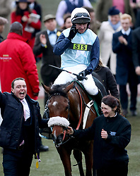 Jockey Noel Mcparlan celebrates winning the Fulke Walwyn Kim Muir Challenge Cup Amateur Riders' Handicap with horse Missed Approach during St Patrick's Thursday of the 2018 Cheltenham Festival at Cheltenham Racecourse.