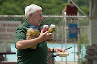 Bob Stuart helps with BBQ lunch preparation for the 70th anniversary celebration for the Kiwanis Pool in St. Johnsbury Vermont.  Karen Bobotas / for Kiwanis International