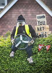 © Licensed to London News Pictures. 27/04/2020. Capel, UK. A scarecrow depiction of a driver sits on a hedge at a house in the Surrey village of Capel. Residents of the village have resurrected their summer tradition of scarecrows in tribute to NHS medical staff and other key workers. Up to 30 of the life size home made doll like characters can be seen in front gardens throughout the village. The public have been told they can only leave their homes when absolutely essential, in an attempt to fight the spread of coronavirus COVID-19 disease. Photo credit: Peter Macdiarmid/LNP