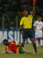 Photo: Steve Bond/Richard Lane Photography.<br /> Guinea v Morocco. Africa Cup of Nations. 24/01/2008. Pascale Feindounou (ground) is shown a straight red card by ref Damon Jerome