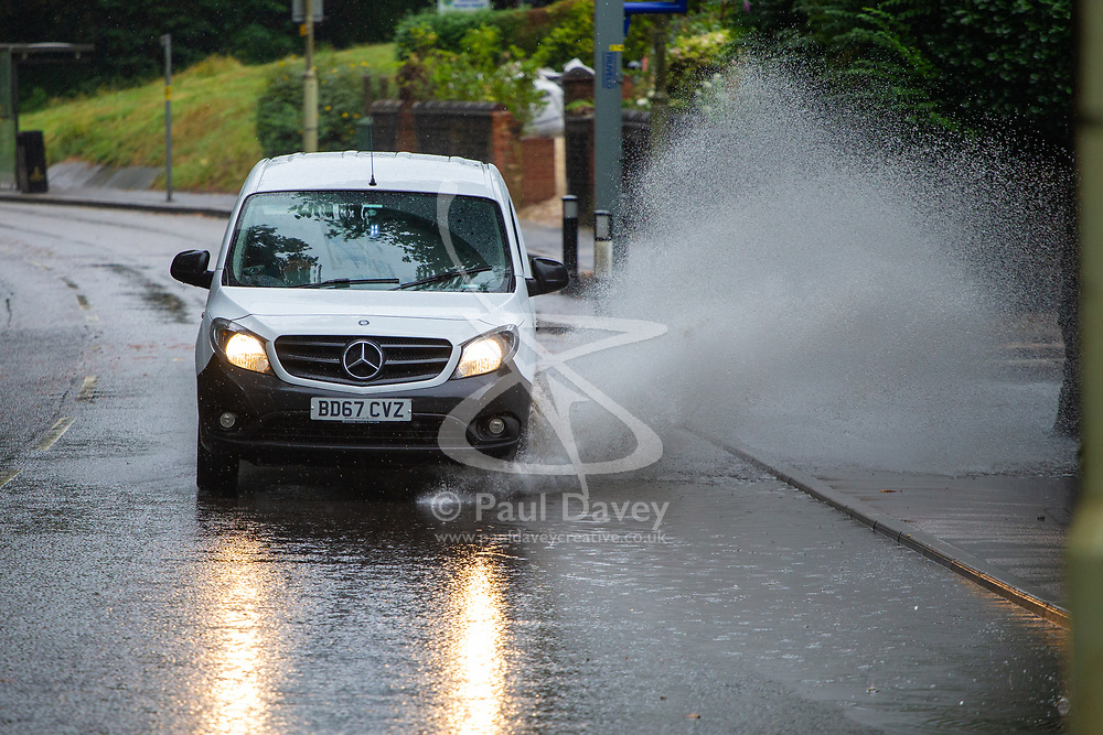 Torrential rain in Watford turns roads into rivers with cars, trucks and buses ploughing through puddles, sending spray flying onto the pavement, putting pedestrians in danger of a possible unexpected soaking. Watford, August 16 2018.