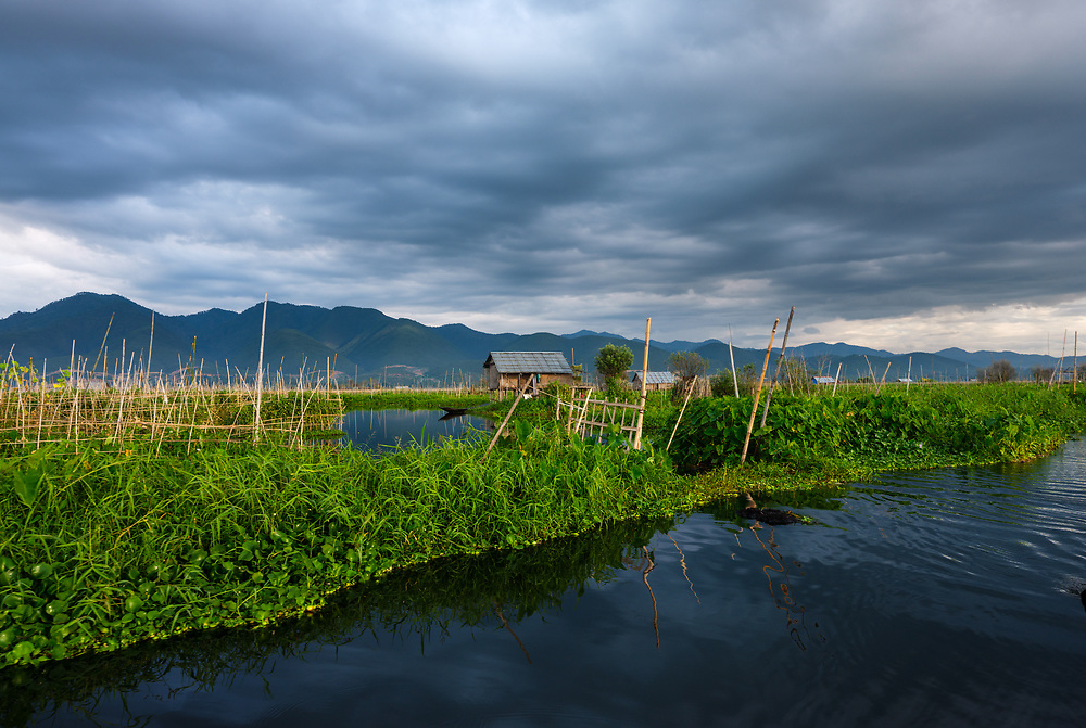 INLE LAKE, MYANMAR - CIRCA DECEMBER 2017: Typical shack on stilts and floating islands in Inle Lake, Myanmar