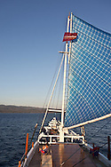 Indonesia, Lombok archipelago, Moyo island, on atraditional boat