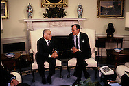 HW Bush and Yitzhak Shamir talk in the Oval Office of the White House on December 11, 1990<br /> Photo by Dennis Brack