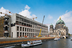 New Humboldt Forum under construction beside Spree River with Berlin Cathedral to rear in Berlin Germany