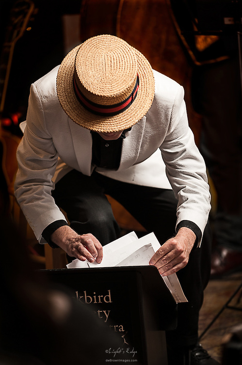 A fine looking straw  Boater Skimmer hat upon Richard Barnes, the leader of The Blackbird Society Orchestra, as they finalize their setup for a performance at The Bus Stop Music Cafe in Pitman, NJ.