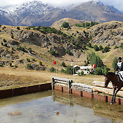 Scott Martin riding Mayko in action at the water jump during the Cross Country event at the Wakatipu One Day Horse Trials at the Pony Club grounds,  Queenstown, Otago, New Zealand. 15th January 2012. Photo Tim Clayton