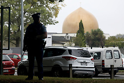 March 18, 2019 - Christchurch, New Zealand - An armed police officer stands guard outside the Al Noor mosque in Christchurch, New Zealand on March 17, 2019. At least 50 people were killed and 36 injured in mass shootings at two mosques in the New Zealand city of Christchurch Friday, 15 March. A 28-year-old Australian born man appeared in Christchurch District Court on Saturday charged with murder. (Credit Image: © Sanka Vidanagama/NurPhoto via ZUMA Press)