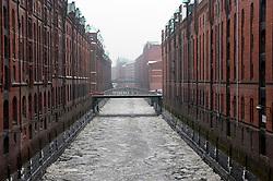 Frozen canals during winter in Speicherstadt historic warehouse district in Hamburg Germany
