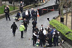 NOTE NUDITY Emergency services at the scene outside the Palace of Westminster, London, after policeman has been stabbed and his apparent attacker shot by officers in a major security incident at the Houses of Parliament.