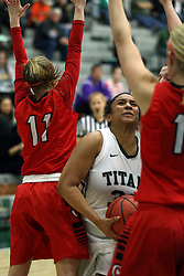 10 January 2015:  Gabrielle Holness splits a pair of defenders to get to the hoop.  (Erin Thomas(11)) during an NCAA women's division 3 CCIW basketball game between the Carthage Reds and the Illinois Wesleyan Titans in Shirk Center, Bloomington IL