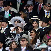 Large crowds watch the races during the race meeting at Royal Ascot Race Course. Royal Ascot is one of the most famous race meetings in the world, frequented by Royalty and punters from the high end of society to the normal everyday working class. Royal Ascot 2009, Ascot, UK, on Friday, June 19, 2009. Photo Tim Clayton.