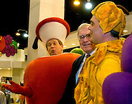Omaha, Neb 5/6/06 Warren Buffet sings with the Fruit of the Loom fruits at the Berkshire Hathaway annual meeting in the Qwest Center Omaha Saturday Morning..(Chris Machian/Prairie Pixel Group)