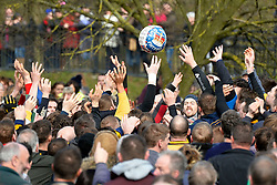 © London News Pictures. 04/03/2014. Ashbourne, UK. The game begins. Two teams, the Up'Ards and the Down'Ards, fight for the ball during the first day of the Royal Shrovetide Football match in Ashbourne, Derbyshire. For two days, over Shrove Tuesday and Ash Wednesday, hundreds of participants battle it out in a 'no rules' game dating back to the 17th Century where the aim is to get a ball into one of two goals that are positioned three miles apart at either end of Ashboune. Photo credit: Ben Cawthra/LNP