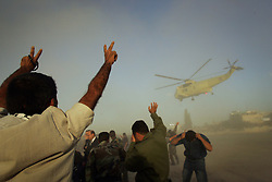 Palestinians pay respect to Egyptian military helicopters that delivered Yasser Arafat's body for the funeral at his compound, Ramallah, Palestinian Territories, Nov. 12, 2004. Arafat died in a Paris hospital at the age of 75.