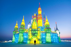 Night view of ice castle at Harbin Ice Lantern Festival in Heilongjiang , China