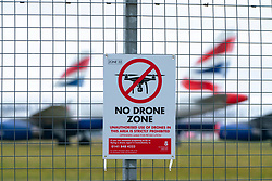 No Drone Zone warning sign on perimeter fence at Glasgow Airport, Scotland ,UK