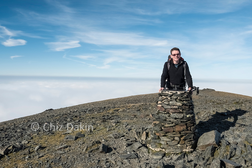 """Nearly all points on a viewpoint cairn just before the main summit might as well say """"fog!"""""""