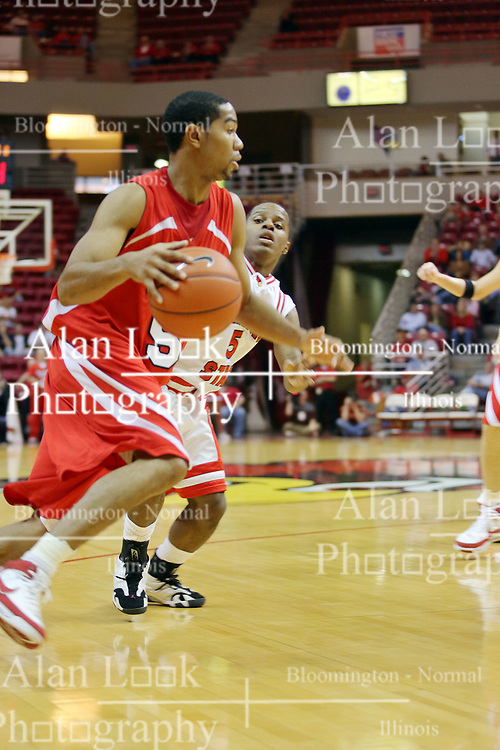 """11 November 2007: Jason Black drives against Keith """"Boo"""" Richardson. Illinois State Redbirds defeated the Missouri - St. Louis Tritons 70-37 in an early season game on Doug Collins Court in Redbird Arena on the campus of Illinois State University in Normal Illinois."""