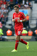 Liverpool's Sebastian Coates in action. Pre-season friendly match, Preston North End v Liverpool at Deepdale in Preston, England on Saturday 19th July 2014.<br /> pic by Chris Stading, Andrew Orchard sports photography.