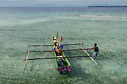 Outrigger fishing canoe<br /> Biak Island<br /> West Papua<br /> Indonesia