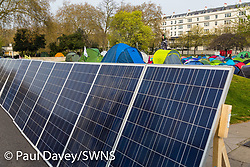 A solar farm has been erected to supply power as hundreds of environmental protesters from Extinction Rebellion occupy Marble Arch, camping in the square and even on the streets, blocking access to traffic on Park Lane and Oxford Street in London's usually traffic-heavy west end. . London, April 16 2019.
