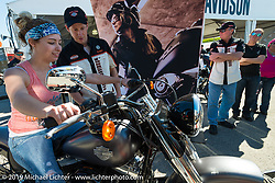 """Lauren Sigler of Findlay, Ohio learns how to shift gears for the first time at Harley-Davidson's """"Jumpstart"""" display during Daytona Bike Week. March 8, 2014.  Photography ©2014 Michael Lichter."""