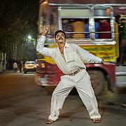Men dancing in the street of Kolkata.