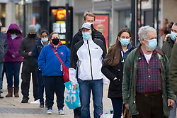 © Licensed to London News Pictures 07/01/2021.         Bexleyheath, UK. People queuing for a self test. A Coronavirus self testing site has been set up on the Broadway in Bexleyheath, South East London. An estimated one in 30 people in London were infected with Covid-19 between December 27th and January the 2nd. Photo credit:Grant Falvey/LNP