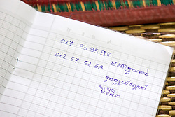 Phone Numbers Written In Notebook, Wat Bo