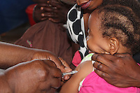 A nurse injects a child with immunization at Metero Reference Clinic in Lusaka, Zambia on Wednesday 12 November 2014