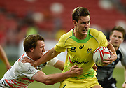 Australia's Lachie Anderson makes a break during the HSBC World Rugby Sevens Series - Singapore, Bronze match Australia-V-England at The National Stadium, Singapore on Sunday, April 16, 2017. (Steve Flynn/Image of Sport)